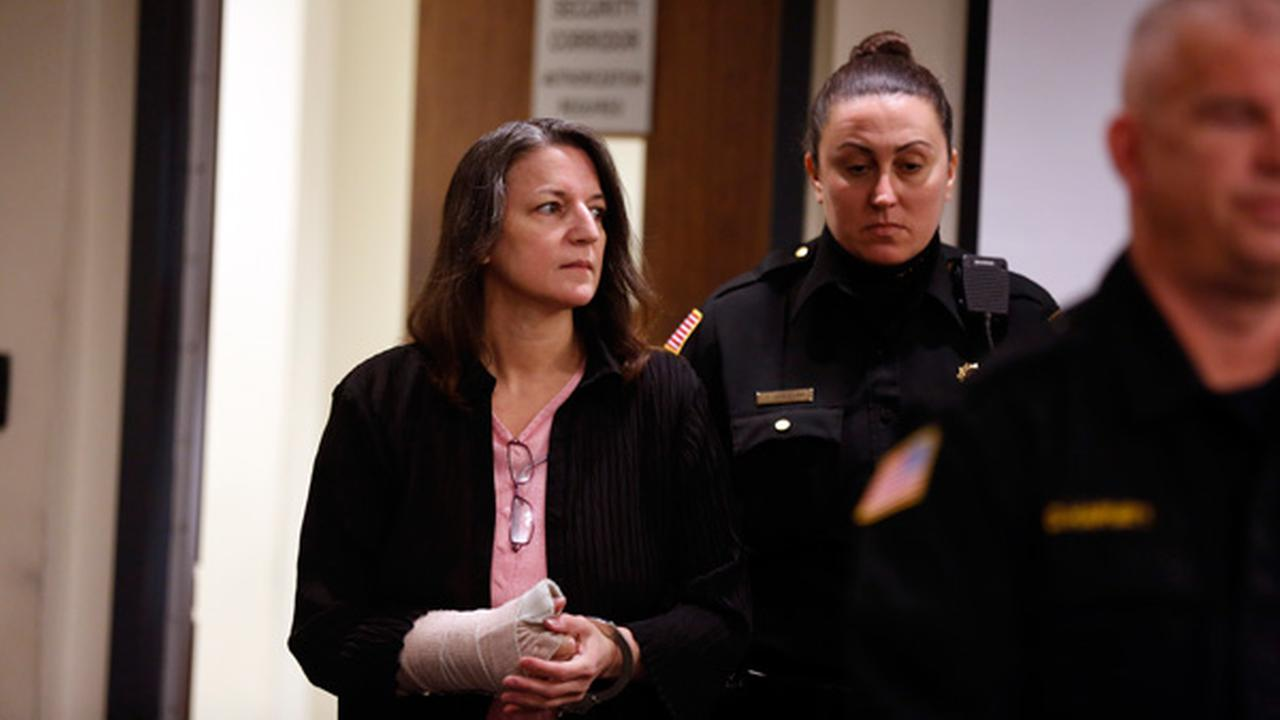 Michelle Lodzinski enters the courtroom Friday, March 18, 2016, in New Brunswick, N.J., at the beginning of the day for her murder trial.Patti Sapone/NJ Advance Media via AP, Pool