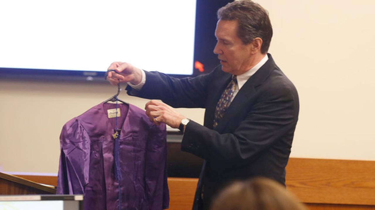 Defense attorney Gerald Krovatin, left, shows the jurors Timothy Wiltseys kindergarten graduation robe during his opening statements in the Michelle Lodzinski murder trial.Patti Sapone/NJ Advance Media via AP, Pool