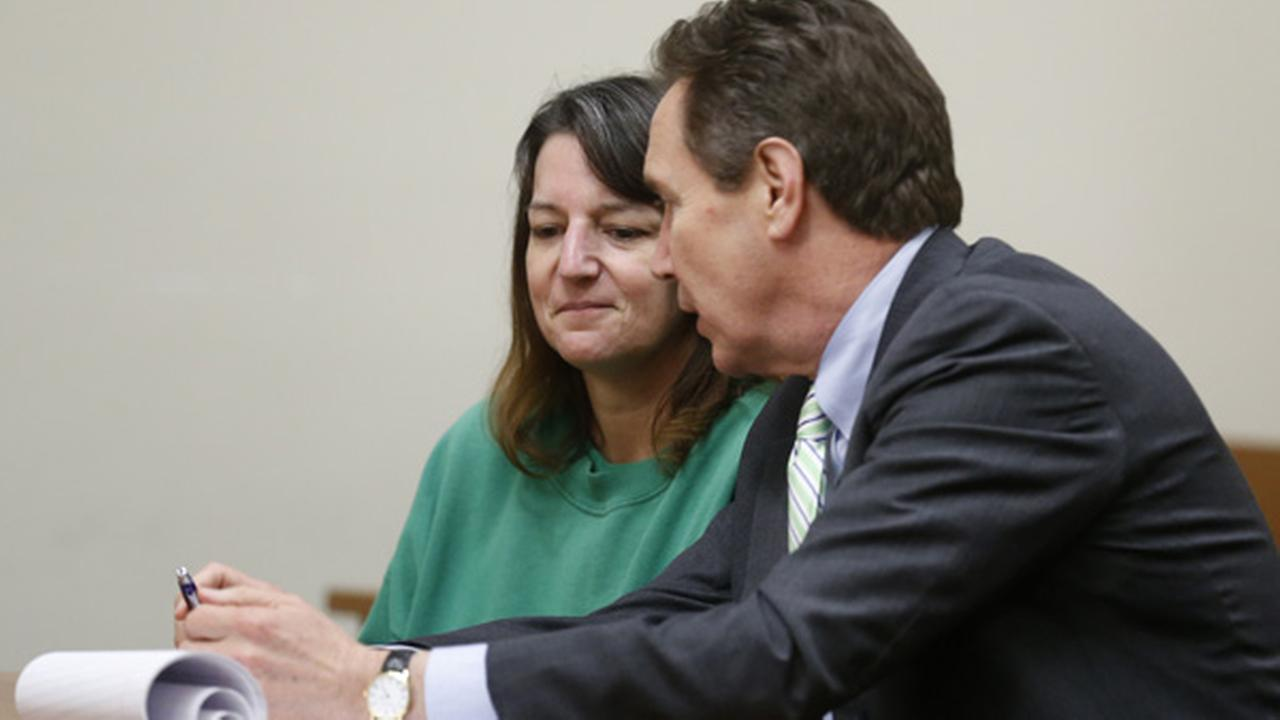 Michelle Lodzinski, left, with her attorney Gerald Krovatin, appears in court for a status conference before Superior Court Judge Dennis Nieves Tuesday, June 2, 2015.Patti Sapone/The Star-Ledger via AP, Pool