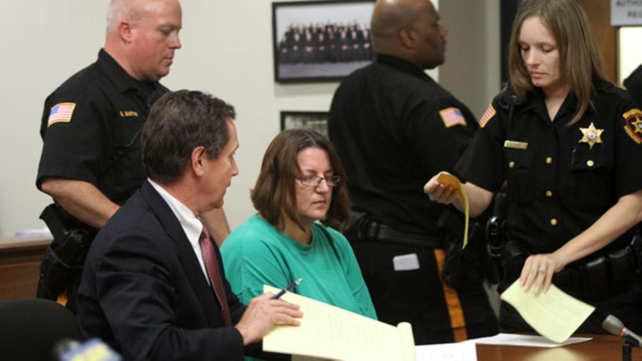 Michelle Lodzinski sits beside her attorney Gerald Krovatin during her arraignment in State Superior Court, Tuesday, Sept. 16, 2014, in New Brunswick, N.J.AP Photo/ Home News Tribune, Jason Towlen