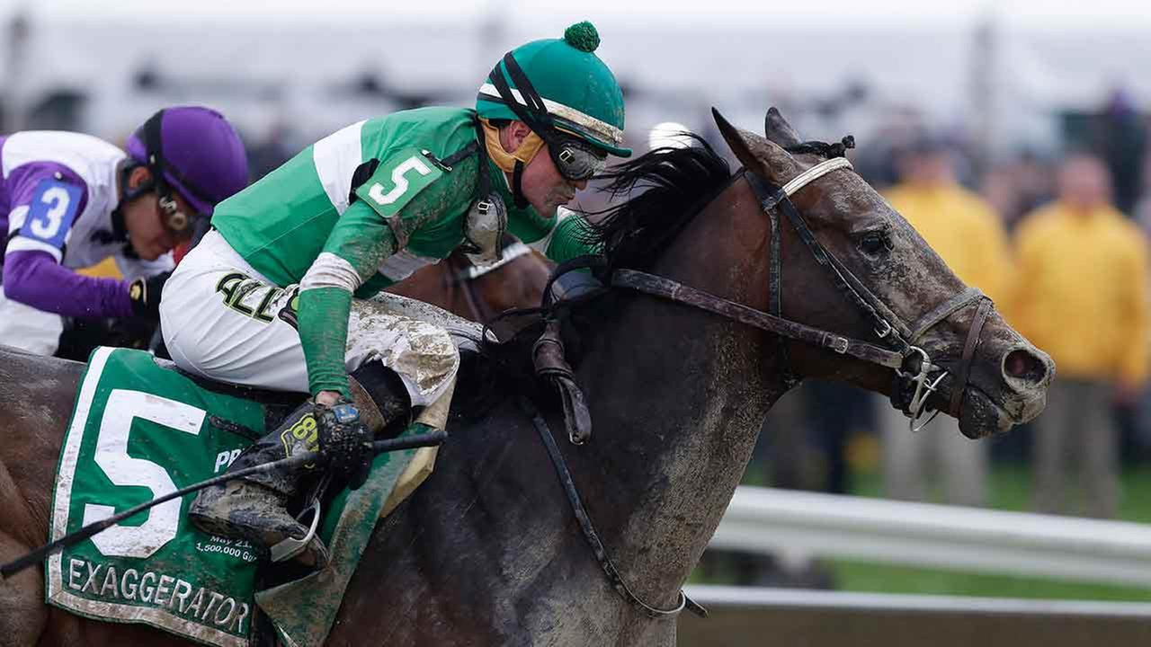 Exaggerator with Kent Desormeaux aboard moves past Nyquist with Mario Gutierrez during the 141st Preakness Stakes horse race.