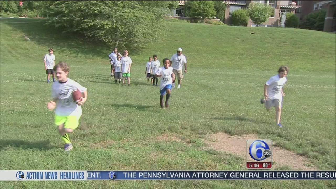 VIDEO: Kids learn football at summer camp