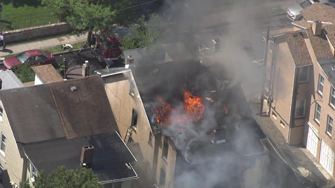 Firefighters work to control a three-alarm fire in Bethlehem, Pa.