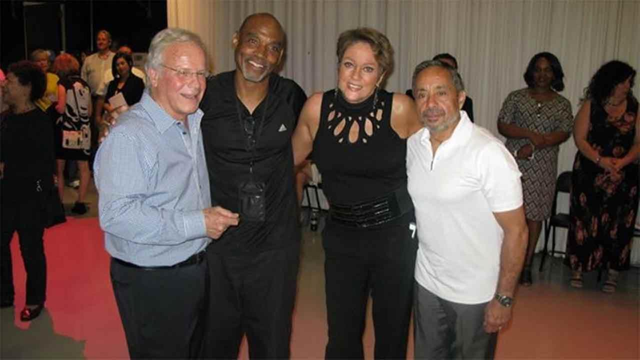 Lisa with colleagues and friends. On the far right is retired Chief Photographer Lou Lozada.