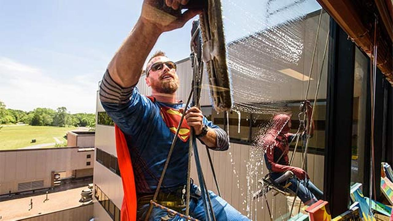 Superman, Spider-Man, Batman and Captain America visited patients and cleaned the windows at University of Missouri Womens and Childrens Hospital.