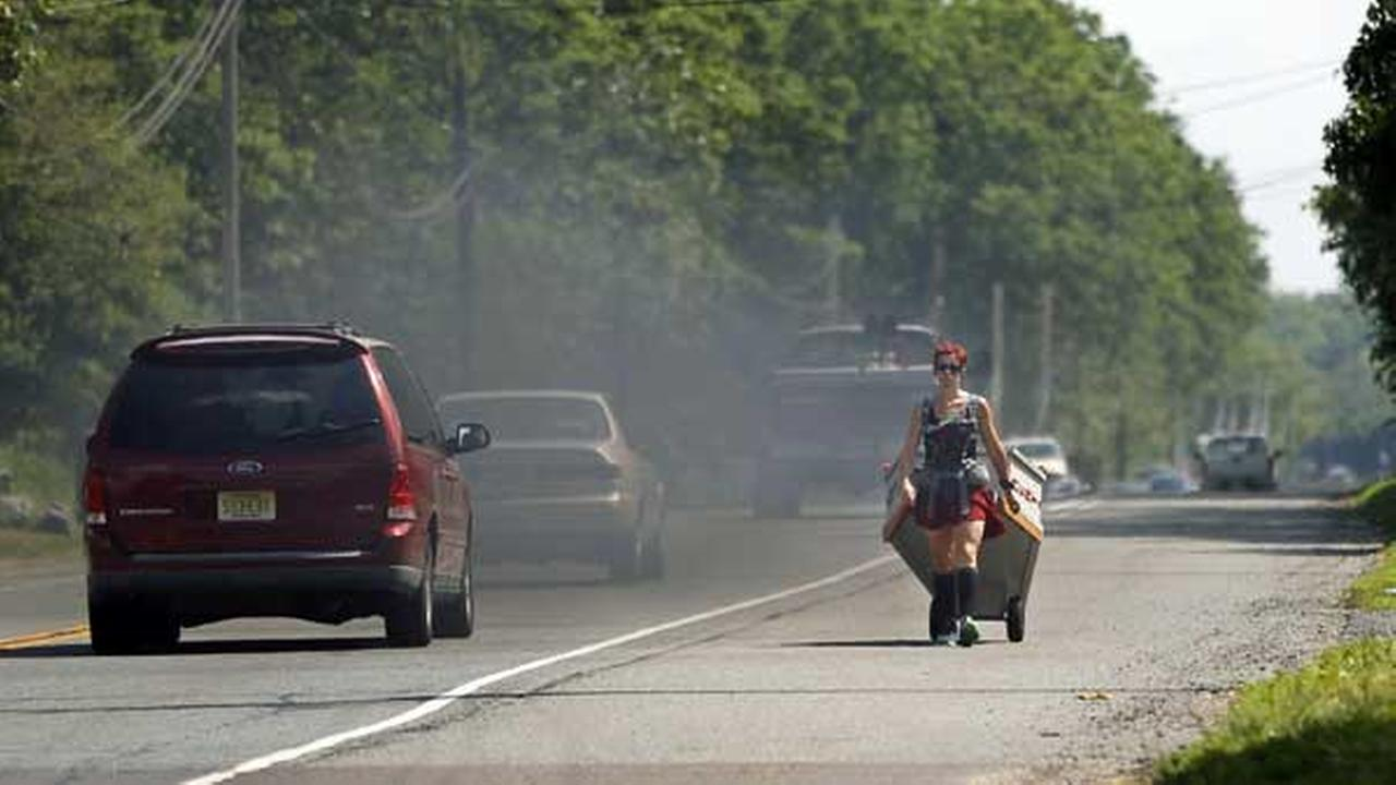 Greta Schwartz, of Seaville, N.J., is dressed like a Spartan warrior pulling a casket as she walks along route 206, from southern New Jersey to Trenton Tuesday, May 31, 2016.AP Photo/Mel Evans