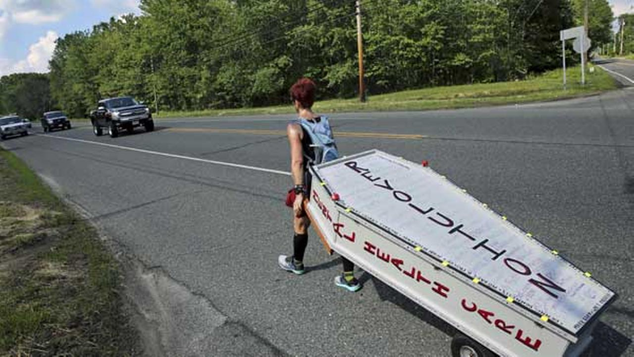 Greta Schwartz, of Seaville, N.J., pulls a casket as she walks along route 206, from southern New Jersey to Trenton Tuesday, May 31, 2016.AP Photo/Mel Evans