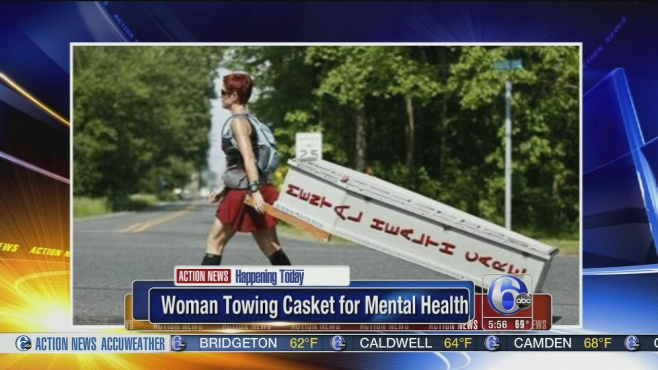 VIDEO: Woman towing casket for mental health