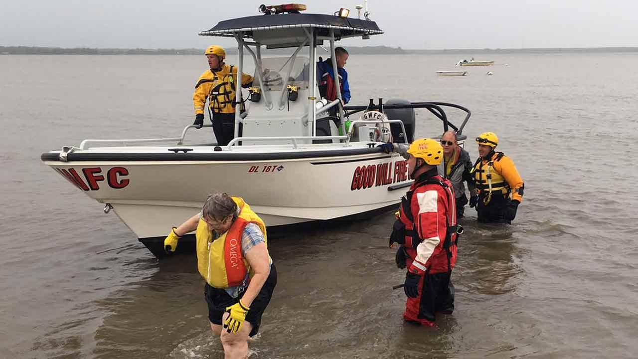 A couple was rescued after strong winds caused their sailboat to capsize on the Delaware River.