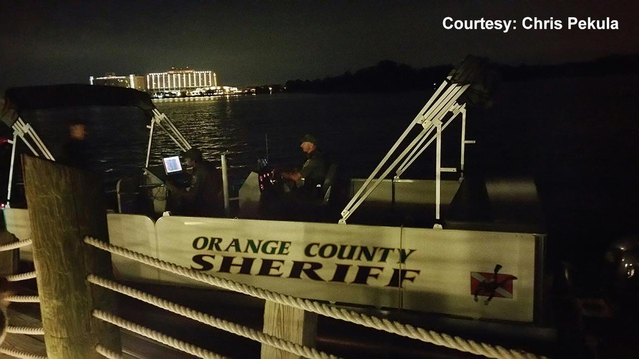 Police search the water near Disneys upscale Grand Floridian Resort and Spa