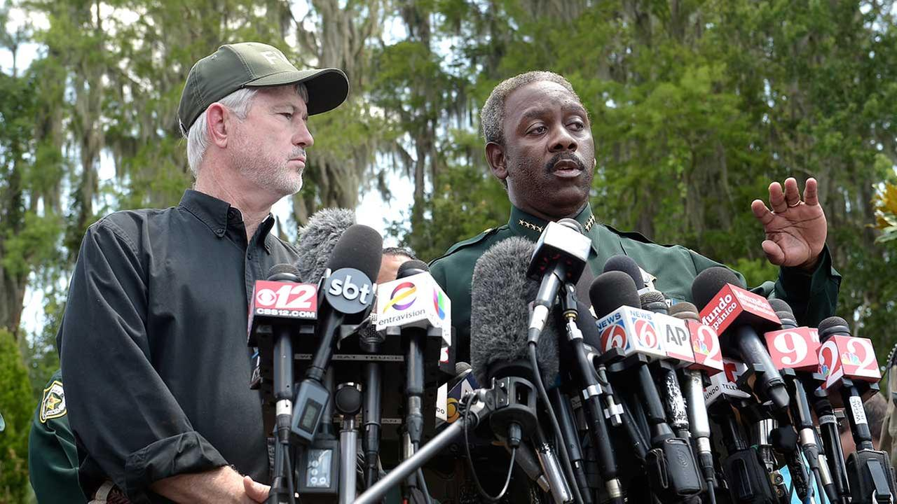 Nick Wiley, executive director of the Florida Fish and Wildlife Conservation Commission, left, and Orange County Sheriff Jerry Demings answer questions from reporters.AP Photo/Phelan M. Ebenhack