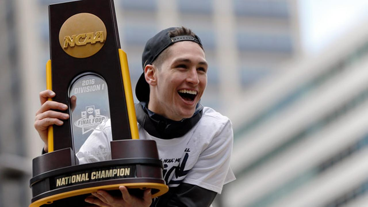 Villanovas Ryan Arcidiacono holds the trophy during a parade celebrating their NCAA college mens basketball championship, Friday, April 8, 2016, in Philadelphia.