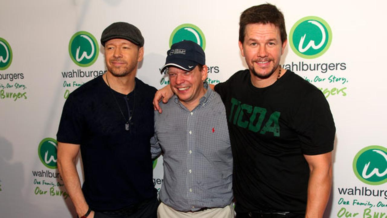 Donnie Wahlberg, from left, Paul Wahlberg and Mark Wahlberg attend the Wahlburgers Coney Island preview party on Tuesday, June 23, 2015, in New York.