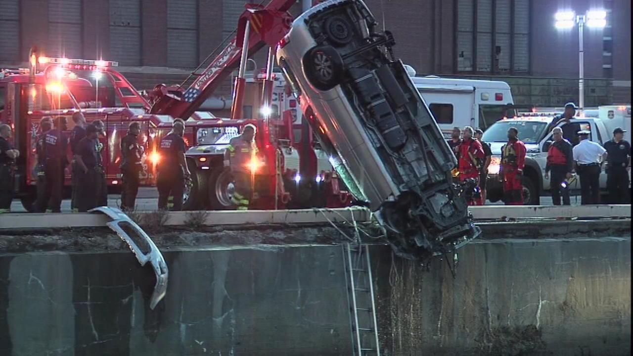Rescue crews pull a minivan out of the Delaware River in South Philadelphia.