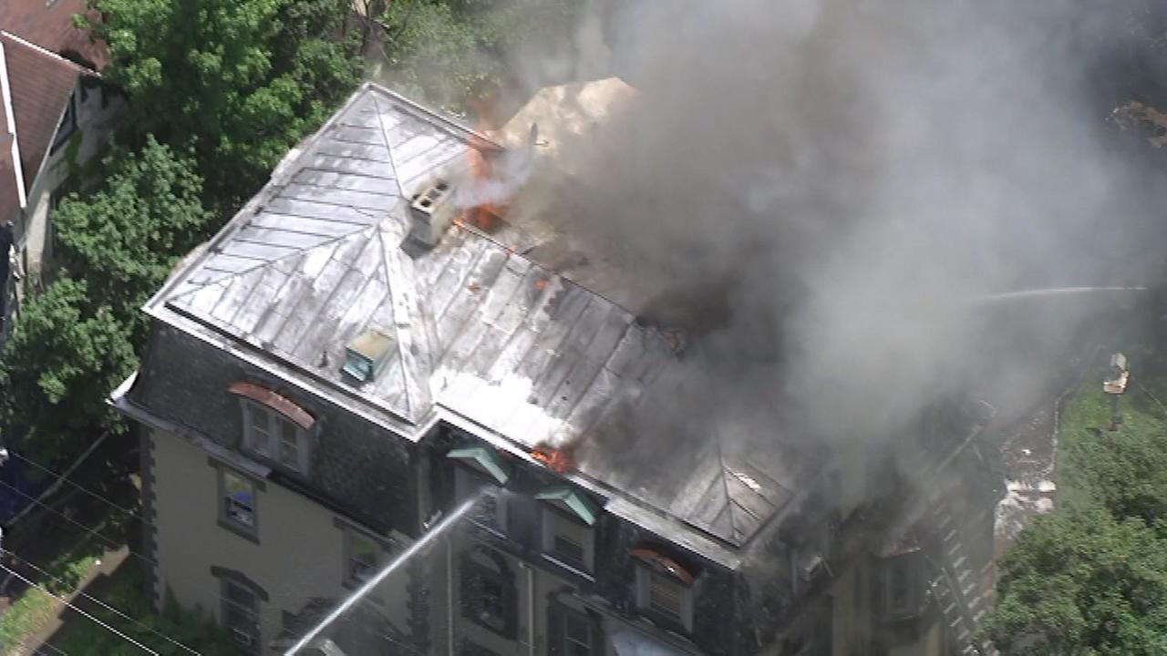 Firefighters battle a fire in the Logan section of Philadelphia.