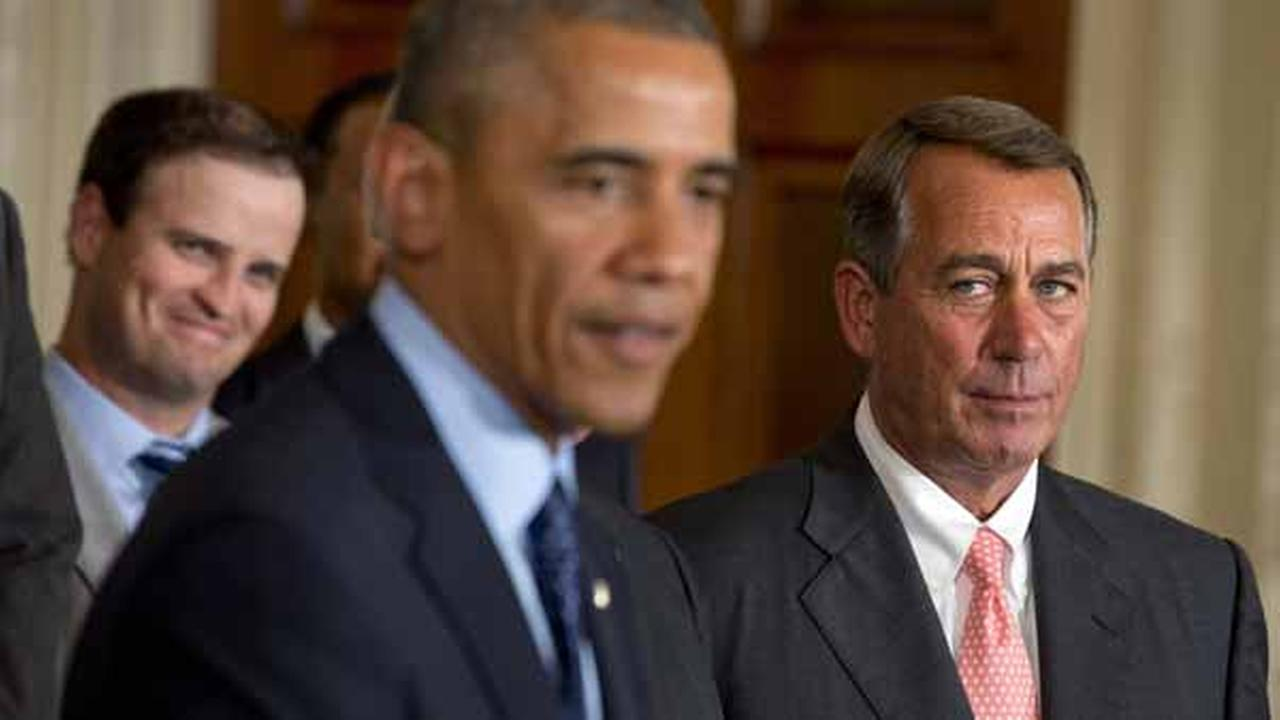 House Speaker John Boehner, R-Ohio, right, watches President Barack Obama speak in the East Room of the White House, Tuesday, June 24, 2014 in Washington.
