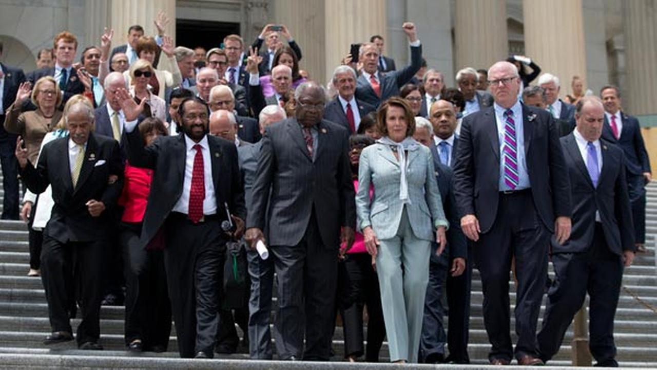 House Minority Leader Nancy Pelosi of Calif., joined by House Democrats walk down the steps of the Capitol in Washington, Thursday, June 23, 2016.