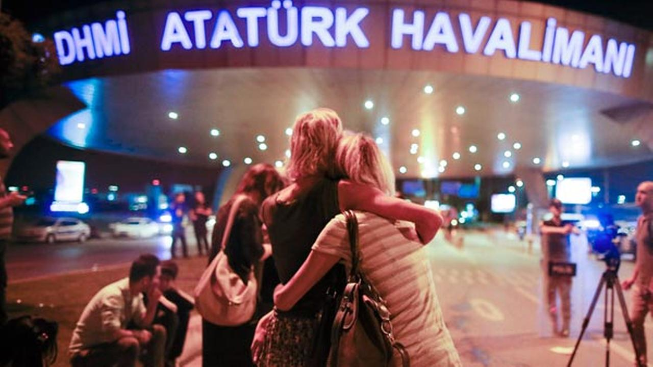 Passengers embrace each other at the entrance to Istanbuls Ataturk airport, early Wednesday, June 29, 2016.