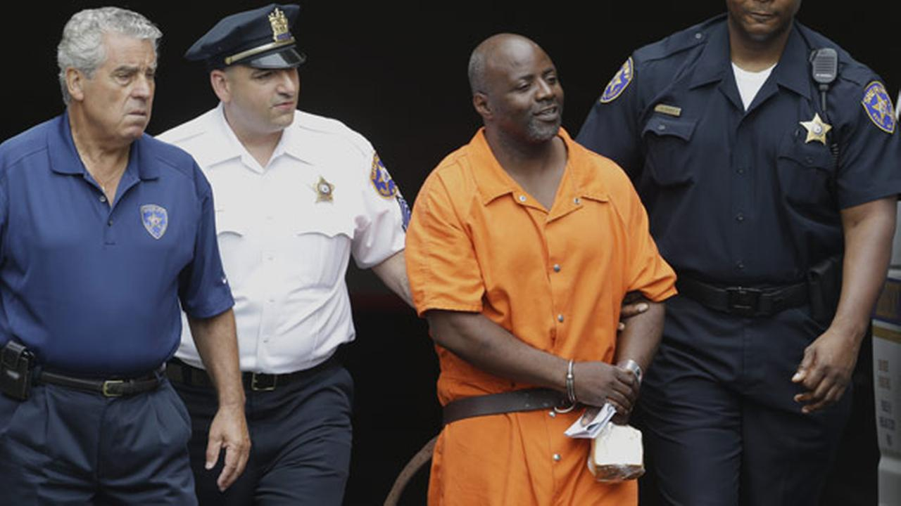 FILE - In this July 2, 2013, file photo, Shawn Custis, center right, is escorted from an arraignment hearing.