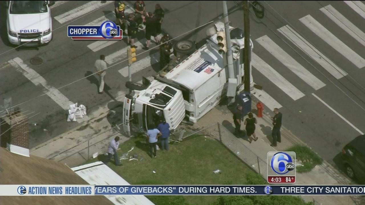 VIDEO: 3 workers hospitalized after trash truck overturns in Juniata Park