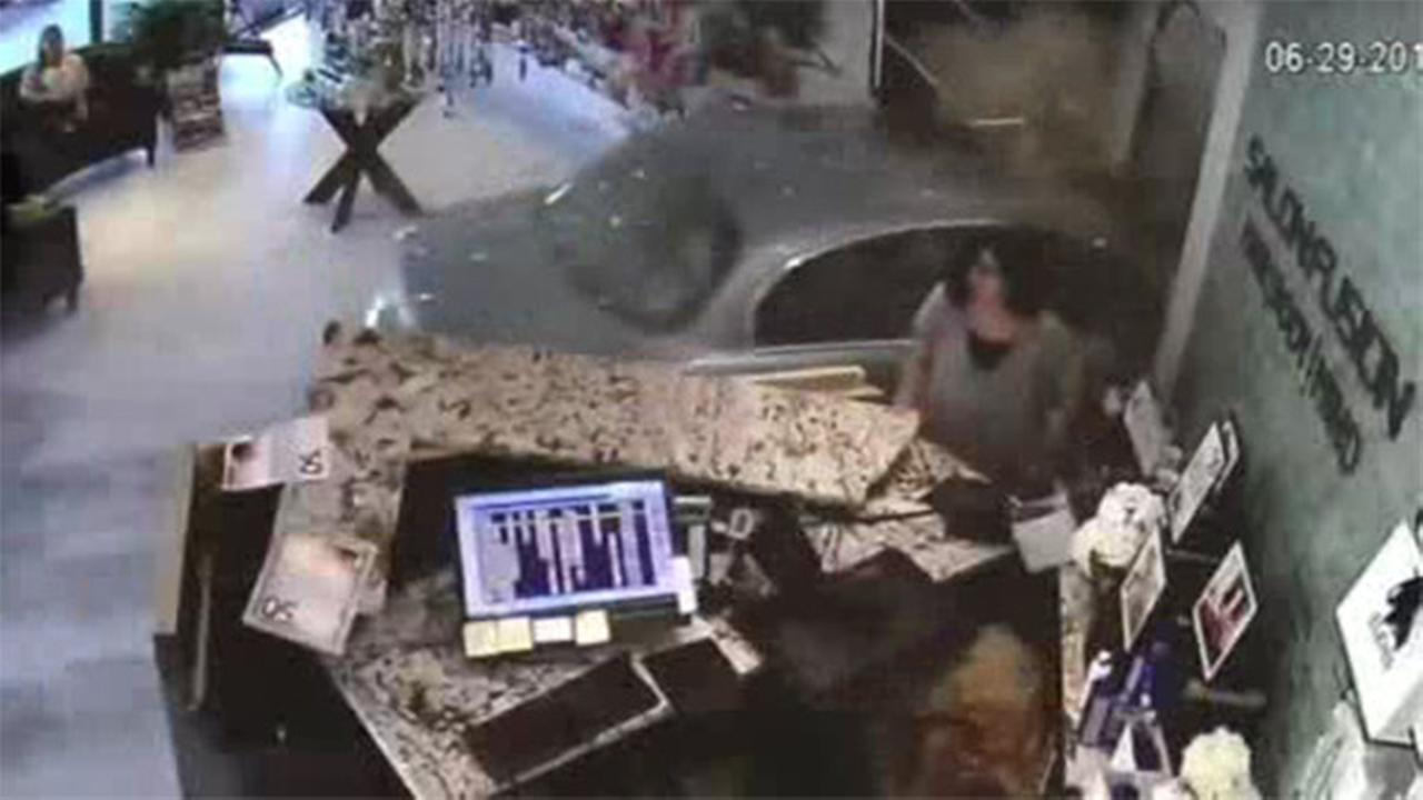 Dramatic video shows a driver crashing into a beauty salon