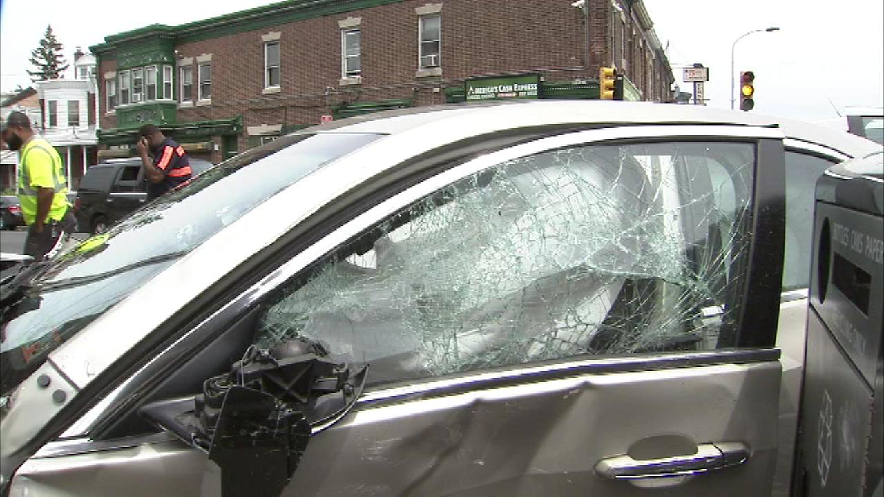 A store was damaged after a crash involving a car and pickup truck in Olney.