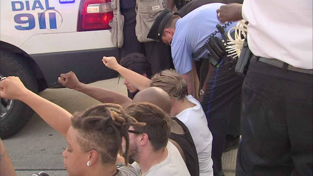 Authorities took a dozen people into custody during a protest in Center City Philadelphia over the death of of Alton Sterling in Baton Rouge, Louisiana.
