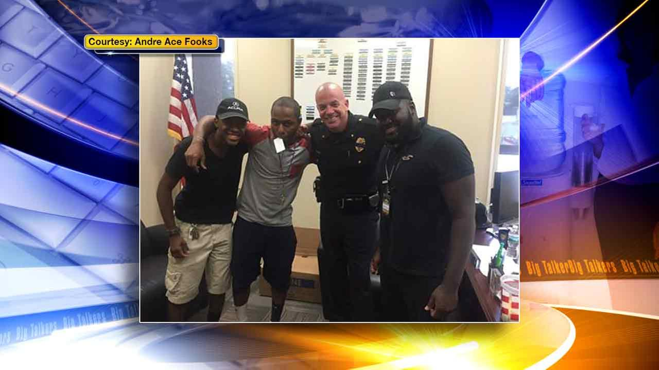 Civilians Andre Fooks, Nigel Newman, and Aaron Grant of Sicklerville, New Jersey started the trend #PicsForPeace and took this photo with Winslow Township Police Chief George Smith