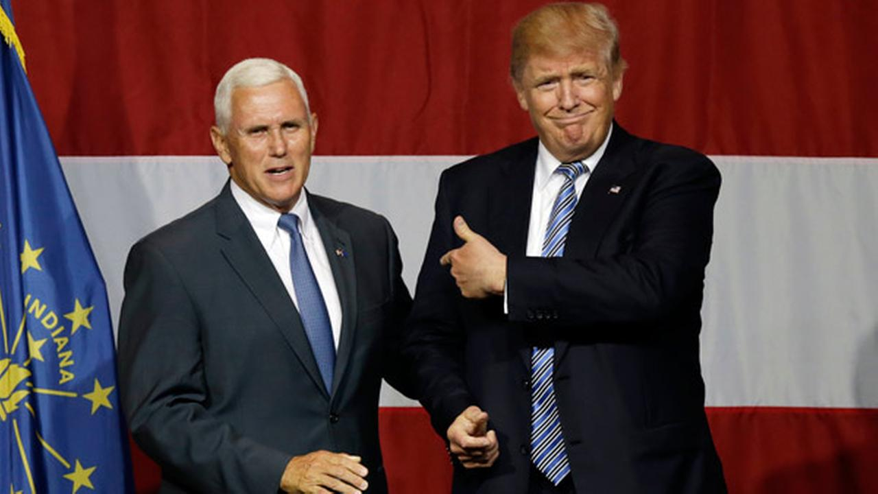 Indiana Gov. Mike Pence joins Republican presidential candidate Donald Trump at a rally in Westfield, Ind., Tuesday, July 12, 2016.