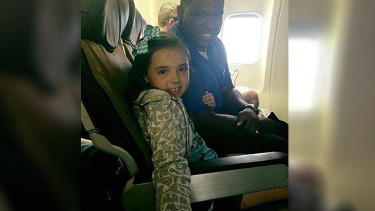 Southwest Airlines employee comforts little girl during flight