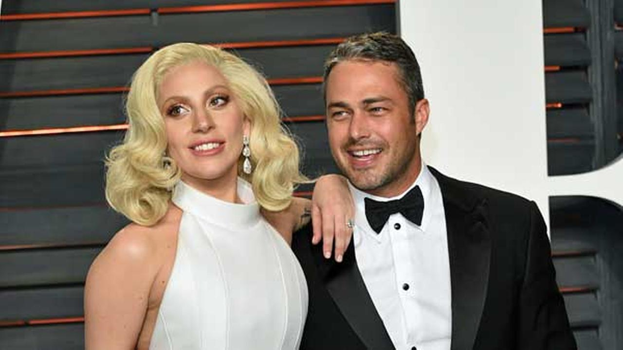 FILE - Actor Taylor Kinney and singer Lady Gaga attend the Vanity Fair Fair Oscar Party at the Wallis Annenberg Center on Sunday, Feb. 28, 2016, in Beverly Hills, Calif.