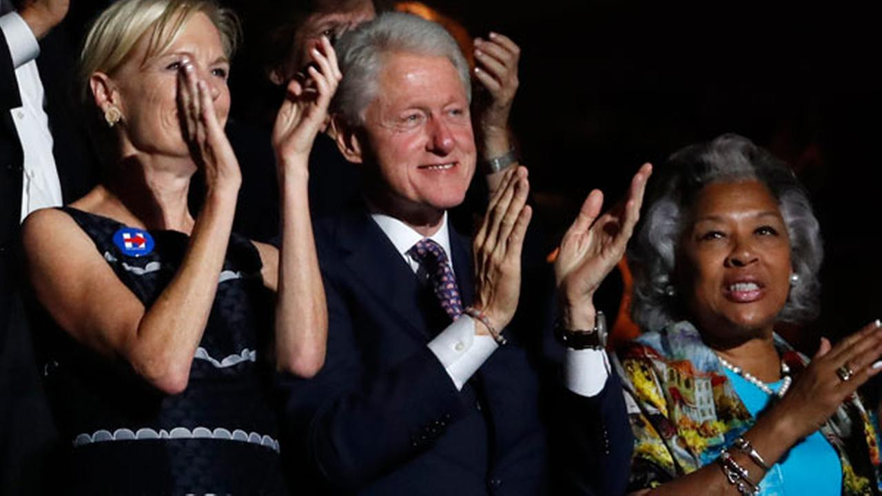 Former President Bill Clinton applauds Former Democratic Presidential candidate, Sen. Bernie Sanders, I-Vt., as he speaks during the first day of the Democratic National Convention
