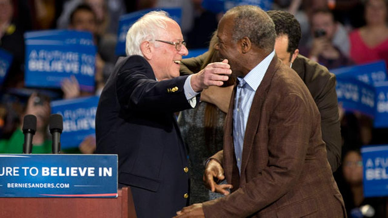 FILE: Democratic presidential candidate Sen. Bernie Sanders, I-Vt., left, embraces actor Danny Glover, during a rally Sunday, Feb. 21, 2016, in Greenville, S.C.