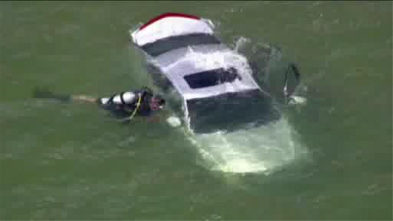 Driver rescued from Michigan lake