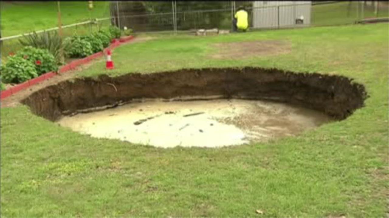 Sinkhole opens into backyard pool