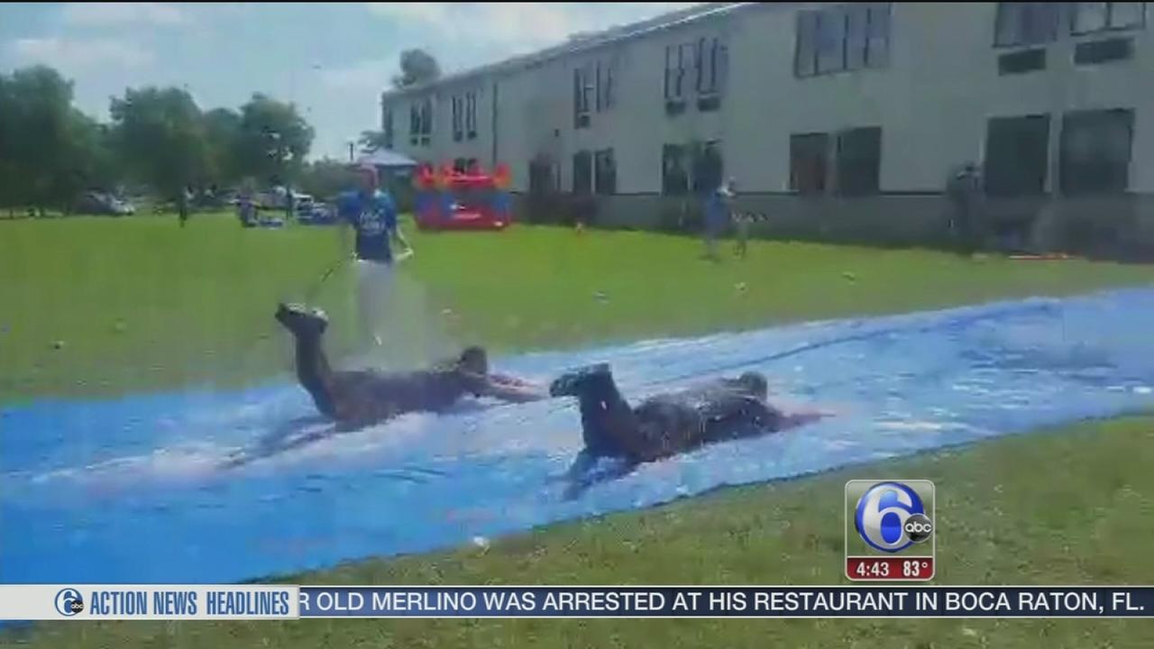 VIDEO: Police officers make a splash on slip-n-slide