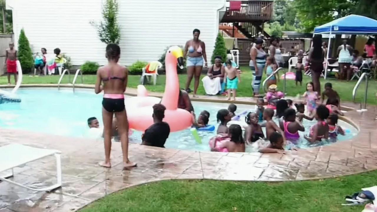 Dozens of children from Trenton were the invited guests for a pool party at the home of Trenton police detective Randall Hanson.