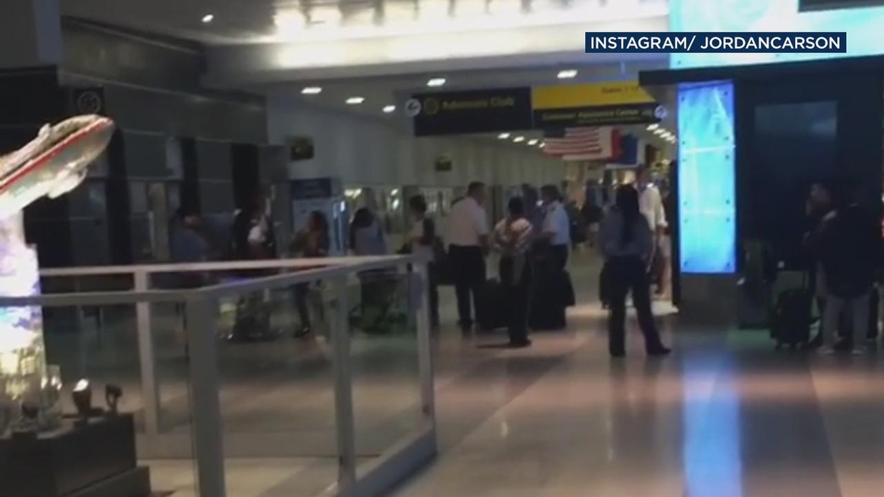 The New York Police Department says officers are responding to John F. Kennedy International Airport following reports of shots fired.