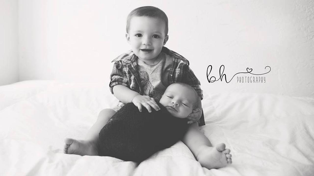 15-month-old Seamus Cullen holds his 2-week-old brother, Conor Eamonn Cullen.Stephanie Anton-Velos, BH Photography