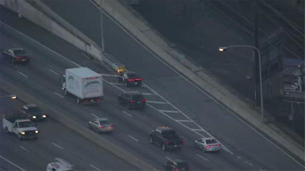 Overturned vehicle jams traffic on EB I-76 approaching vine