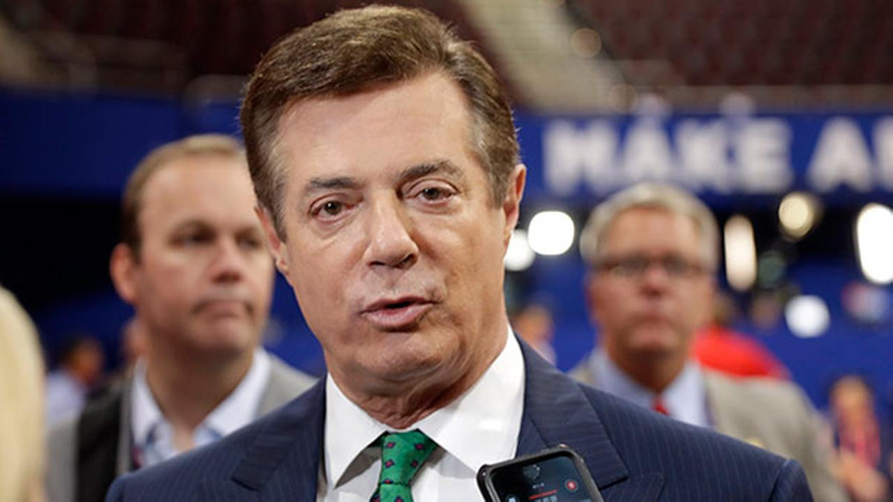 FILE - In this July 17, 2016 file photo, Trump Campaign Chairman Paul Manafort talks to reporters on the floor of the Republican National Convention.