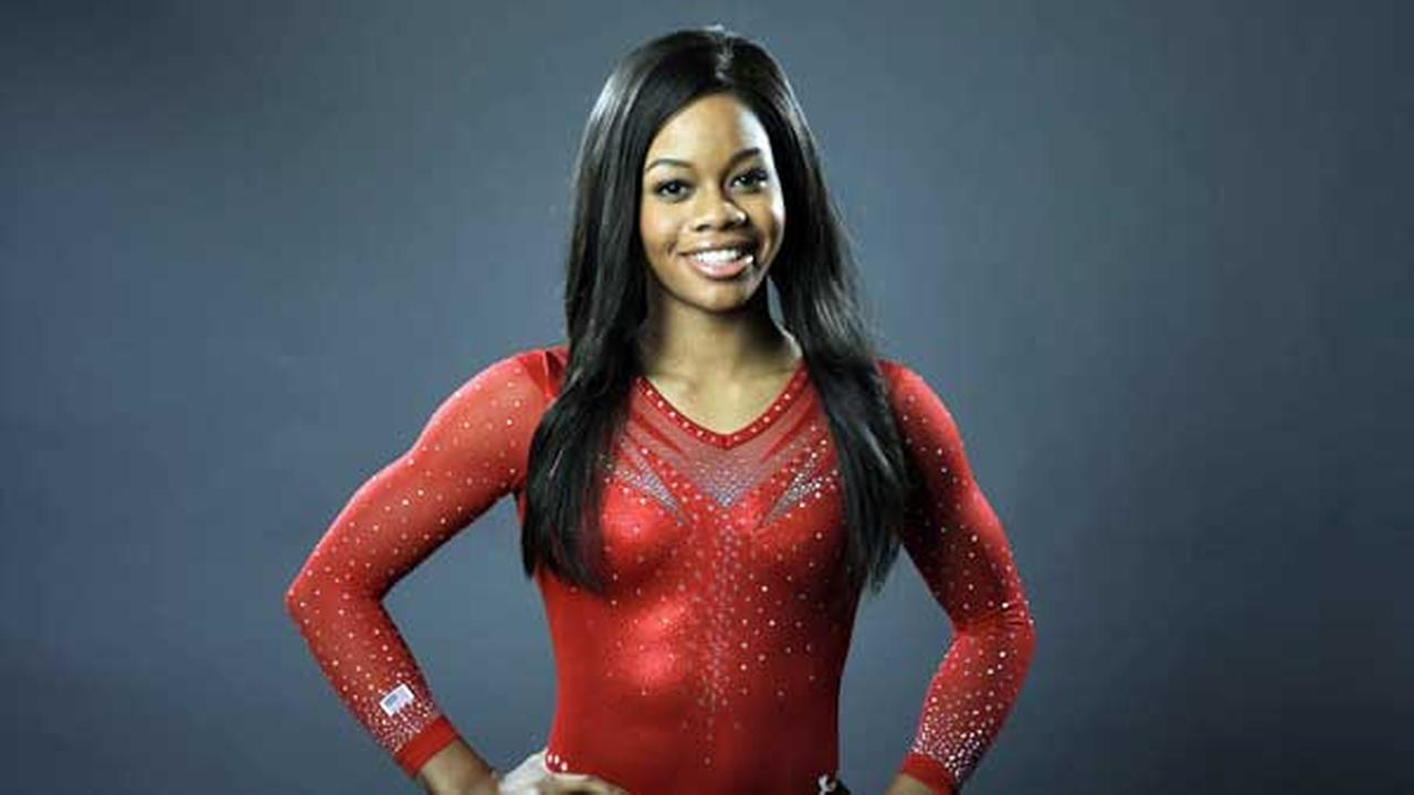 FILE - Gymnast Gabby Douglas poses for photos at the 2016 Team USA Media Summit Monday, March 7, 2016, in Beverly Hills, Calif.