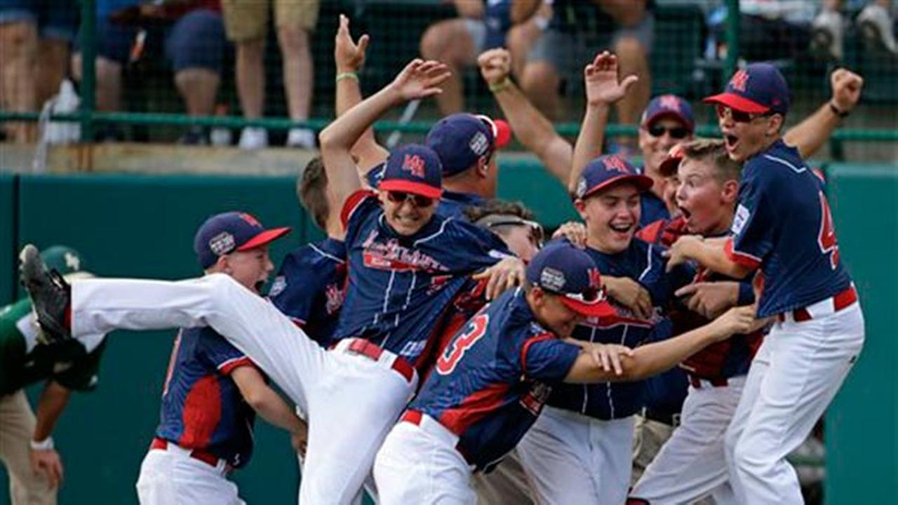 Endwell, N.Y. celebrates its 2-1 win over South Korea in the Little League World Series Championship baseball game in South Williamsport, Pa., Sunday, Aug. 28, 2016. (AP Photo/Gen