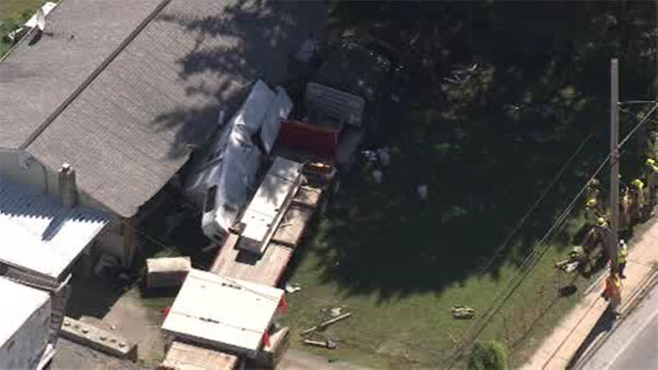 Tractor-trailer crashes into car and building in Chester Co.