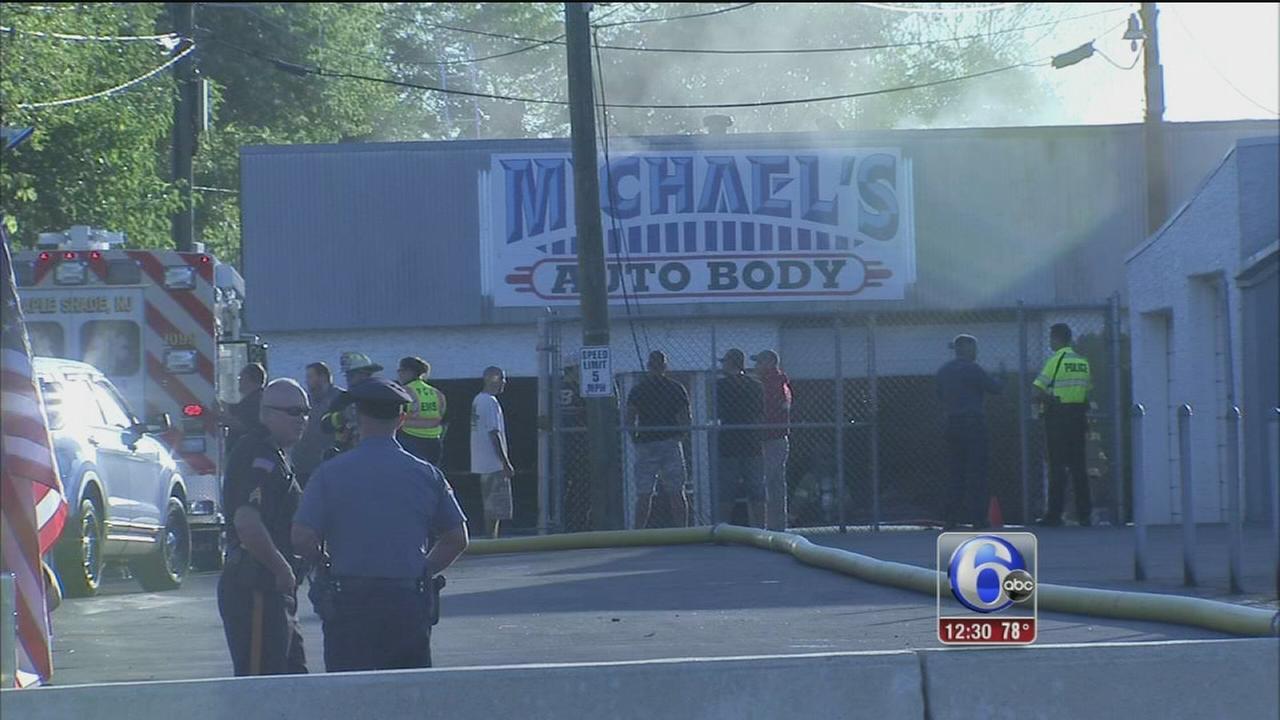 VIDEO: Fire ravages auto body shop