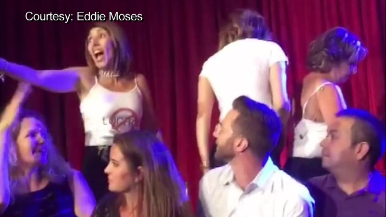 September 12, 2016: Two men wearing Anti-Lochte t-shirts disrupted the live Dancing with the Stars premiere in California.