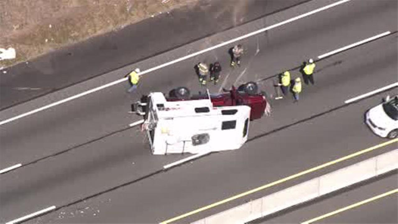 Pickup with camper rolls over on Pa. Turnpike