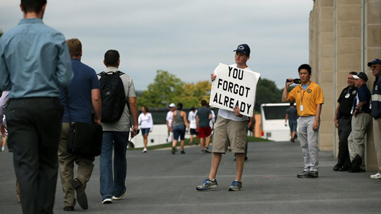 Andrew Limauro, a sophomore from Pittsburgh Pa., stands outside Beaver Stadium protesting the schools decision to honor former head coach Joe Paterno.