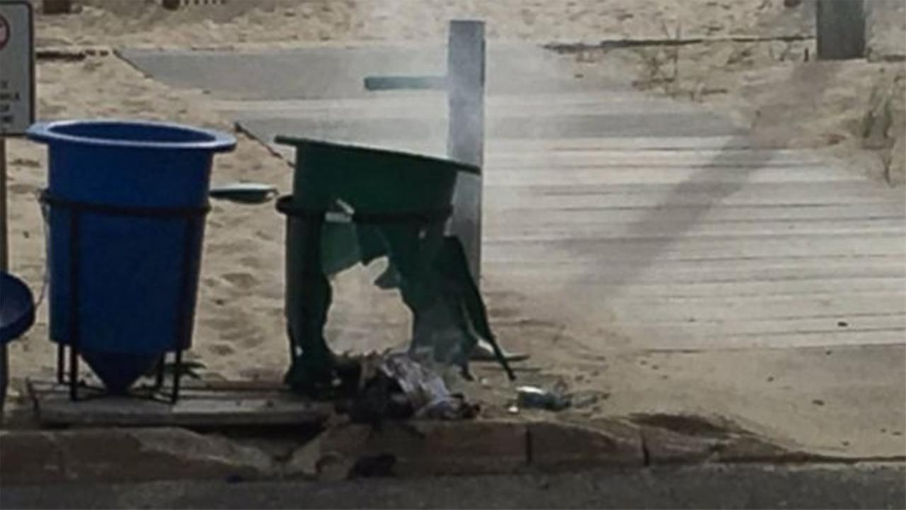 Jersey Shore beaches were reopened Sunday as an investigation continued into a pipe bomb explosion at a seaside community.
