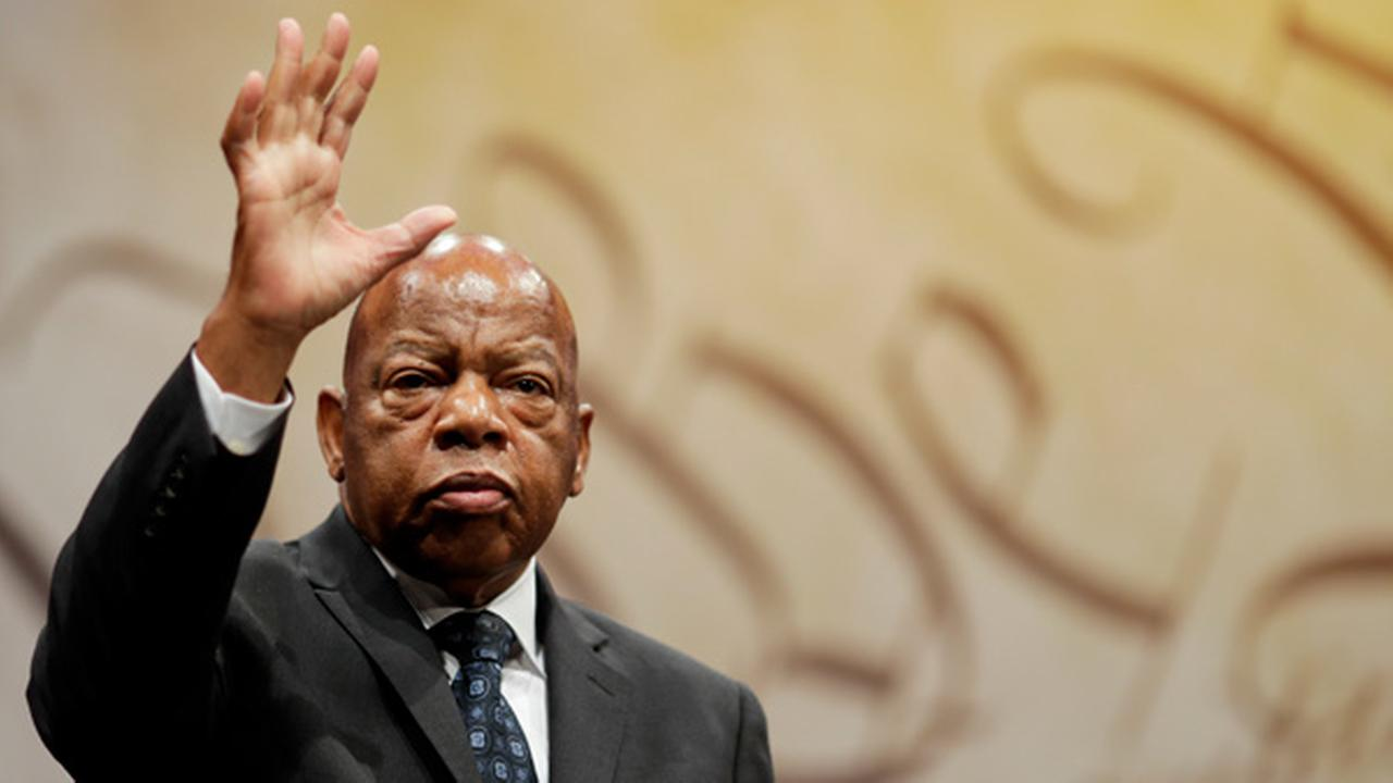 Rep. John Lewis, D-Ga., waves after being presented with the Liberty Medal for his dedication to civil rights during a ceremony at the National Constitution Center.